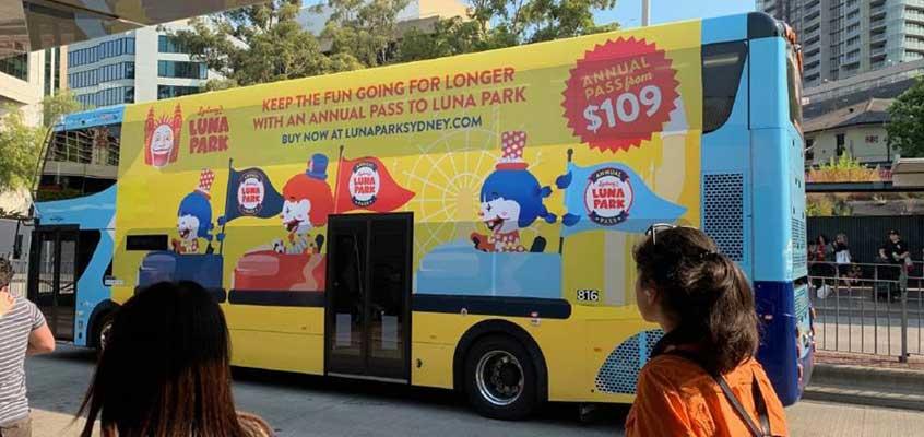 Luna Park bus advertising on Sydney city street